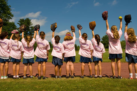 Young campers prepare for a softball game.