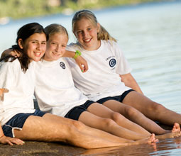Three close friends at Tripp Lake Camp for Girls.