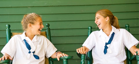 Two campers share a laugh.