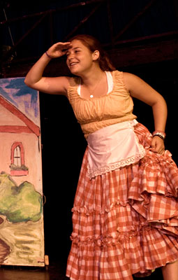 A A young acress performs in a play at Tripp Lake's Theatre.